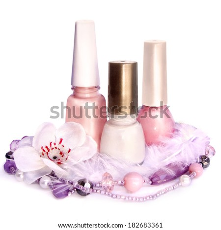 Nail polish and pearls, isolated on white background - stock photo