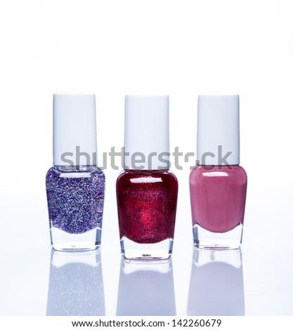 nail polish bottle on white background - stock photo