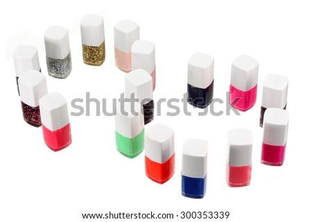 Nail Polish Bottles on White Background - stock photo