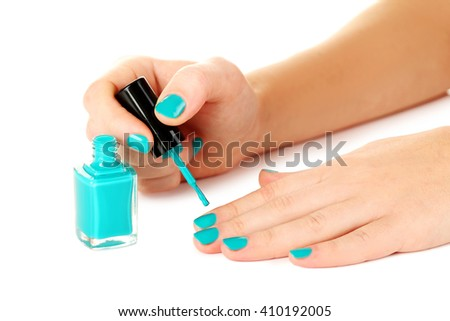 Nail polish in the woman hand on a white background - stock photo