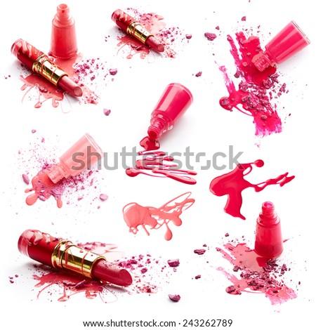 Nail polish, lipstick and crushed eye shadow isolated on white background - stock photo