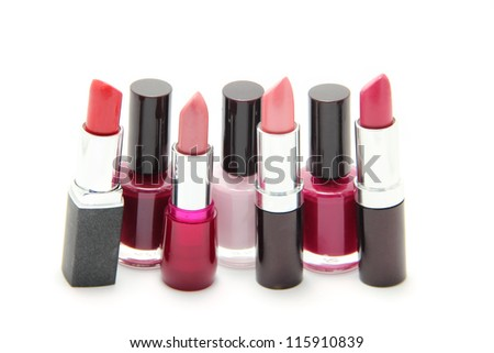 Nail polishes and lipsticks of different shades isolated on white - stock photo