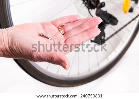 Nail  punch a hole in the bike