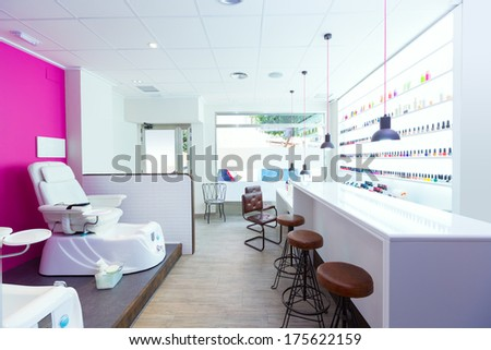 Nail saloon and pedicure chair spa modern with nail polish colorful in a row on white background - stock photo