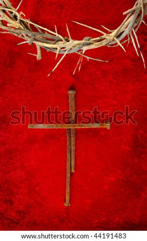 Nail spike cross with a crown of thorns. - stock photo