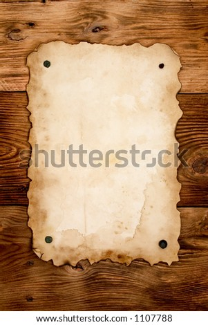 Nailed old paper - stock photo