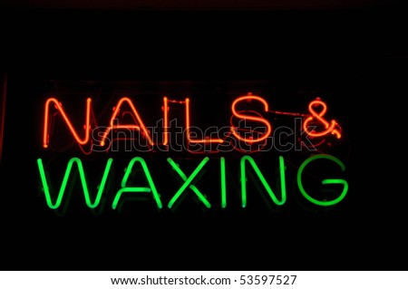 Nails and Waxing Neon Light Salon Sign - stock photo