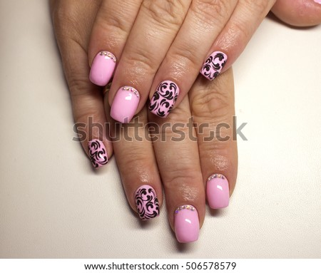 Female hand floral art design nails stock photo 260890520 nails beautiful pink nail polish with a matte black design and rhinestones prinsesfo Image collections