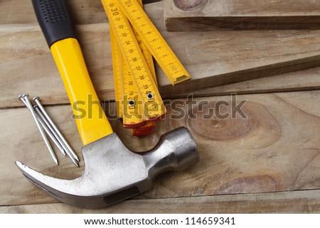 Nails, hammer and folding ruler - stock photo