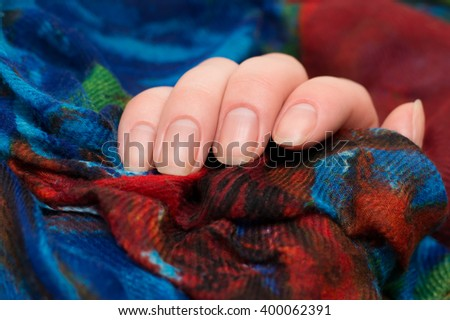 nails in red cloth - stock photo