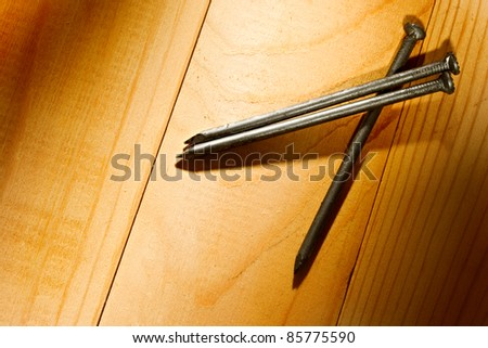 Nails isolated on the wooden background