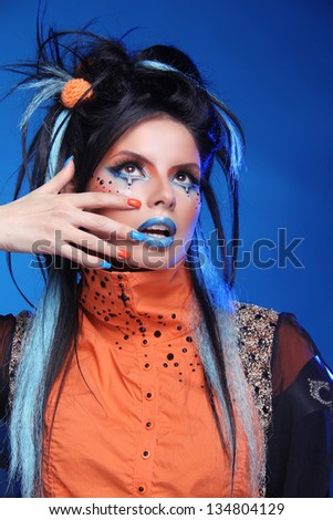 Nails Manicured. Make up. Close up of woman face with colorful makeup. Studio portrait - stock photo