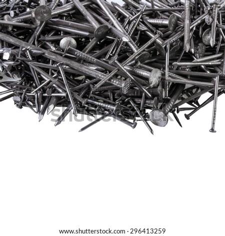 Nails of various sizes isolated on white background - stock photo