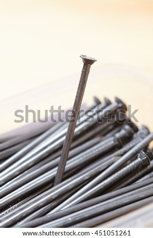 nails on the wood background - stock photo