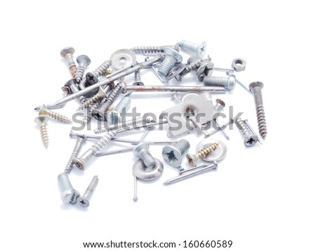 Nails, screws and nuts on a white background