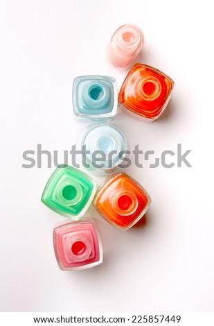 Nails varnish bottles on white background - stock photo