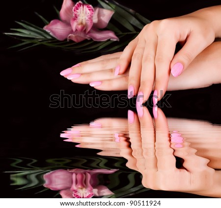 Nails with flower on black - stock photo