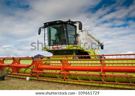 NAIRN, SCOTLAND - JULY 28: Claas Lexion 580 combine harvester on display at the annual Nairn Farmers Show on July 28, 2012 in Nairn, Scotland - stock photo