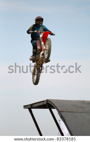 NAIRN, SCOTLAND - 30 JULY: Dan Clark from the Xtreme Motor Cycle Display Team performs at the annual Nairnshire Farmers Show on 30 July 2011 in Nairn, Scotland - stock photo
