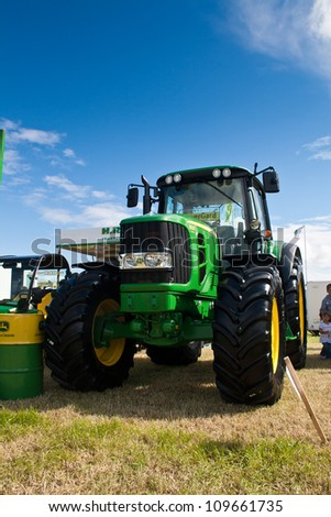 NAIRN, SCOTLAND - JULY 28: New John Deere 6930 tractor on display at the annual Nairn Farmers Show on July 28, 2012 in Nairn, Scotland - stock photo