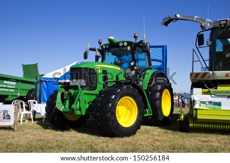 NAIRN, SCOTLAND - JULY 27: New John Deere 7530 tractor on display at the annual Nairn Farmers Show on July 27, 2013 in Nairn, Scotland