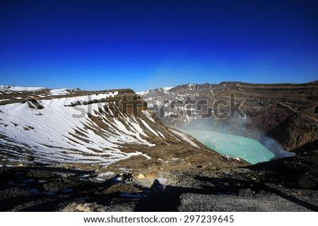 Naka crater, part of Aso San volcano, Kumamoto, Kyushu, Japan. A famous tourist destination. - stock photo