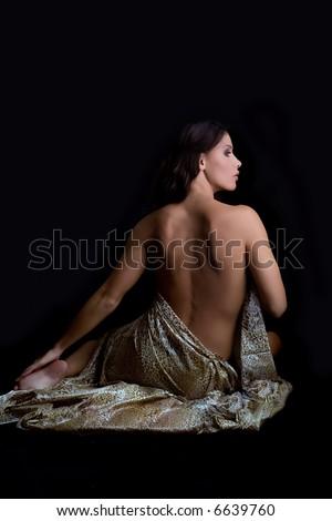 naked back of a beautiful woman, dramatic light - stock photo