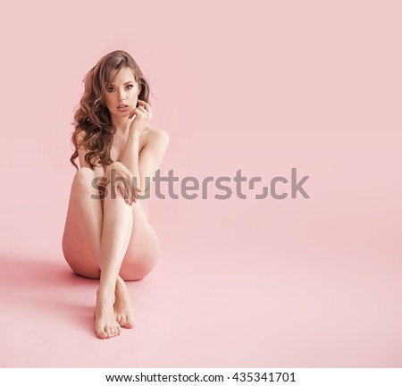 Naked brunette beauty posing in the studio - stock photo