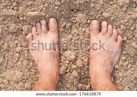 Naked Feet on Soil - stock photo