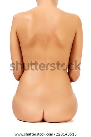 Naked female back, white background, isolated - stock photo