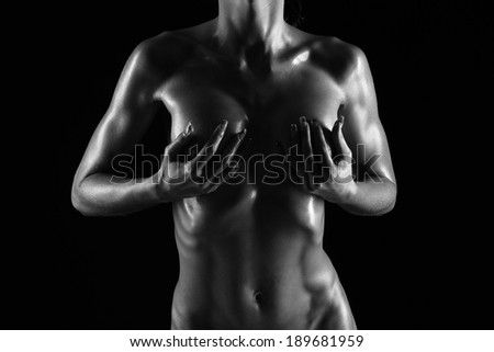 naked female body on a black background