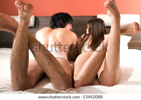 Naked girl and boy in bed