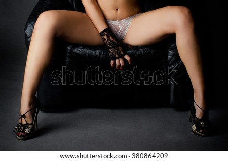 Naked girl sitting in the armchair