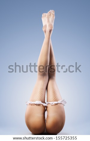 naked girl with long legs in beautiful stockings - stock photo