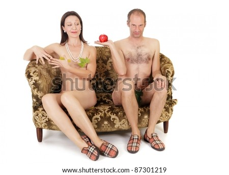 naked kitsch couple seduction on retro couch, adam and eve concept - stock photo