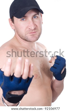 Naked man in gloves in a pose of a boxer