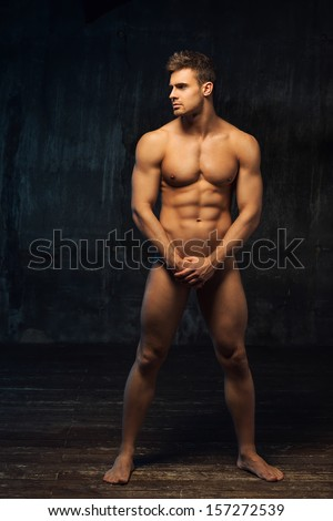 naked man standing sideways - stock photo