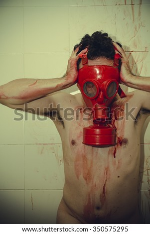 naked man with red gas mask, blood, despair and suicide - stock photo