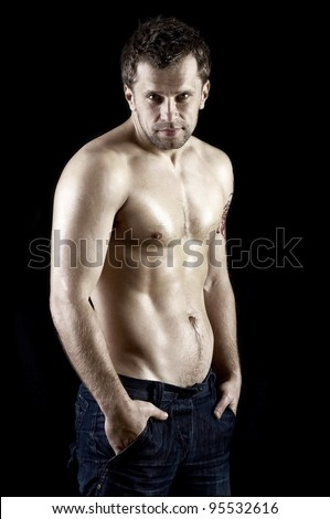 Naked muscular male model in jeans