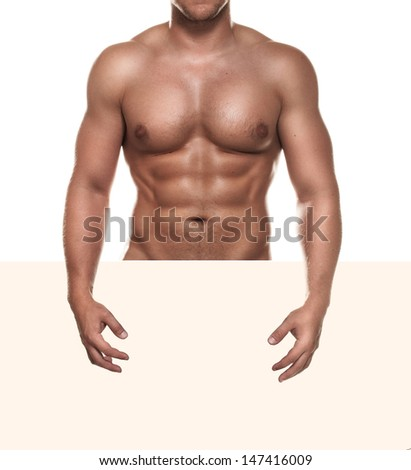 Naked muscular man covering with a copy space blank sign isolated on white - stock photo