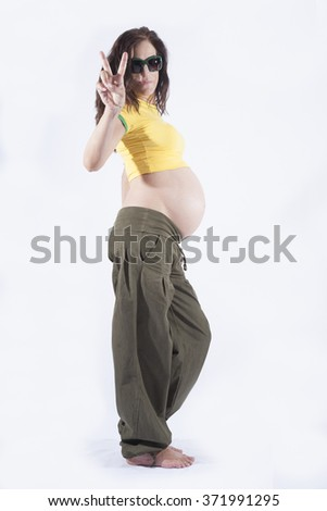 naked paunch eight month pregnant woman with brazilian colors shirt celebrating success winner isolated on over white background - stock photo