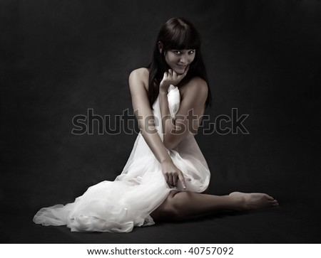Naked sexy beautiful slenderness young woman in bridal veil on black background. Low key studio shot. Great for calendar. - stock photo