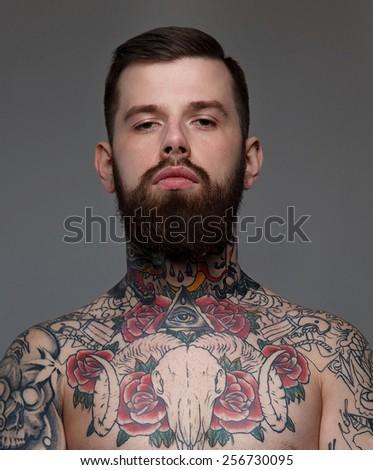 Naked tattooed male with beard. - stock photo