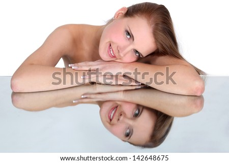 Naked woman and her reflection. - stock photo