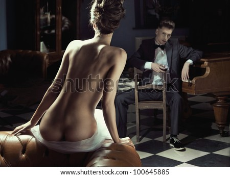 Naked woman and young man - stock photo