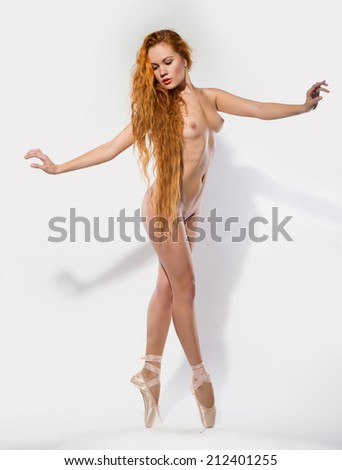 Naked woman dancing. On her feet wearing ballet shoes. - stock photo