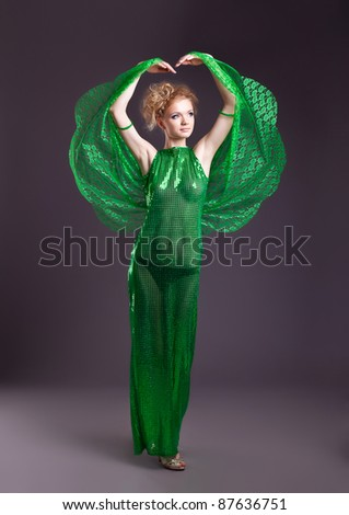 Naked woman in green transparent dance costume - stock photo