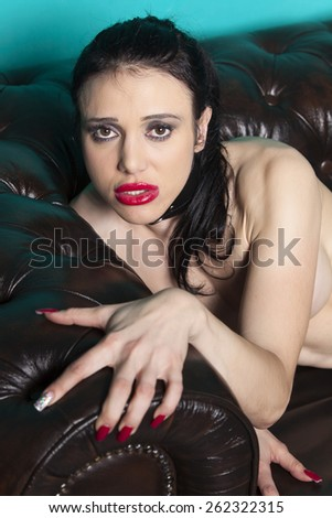 naked woman on a couch  - stock photo