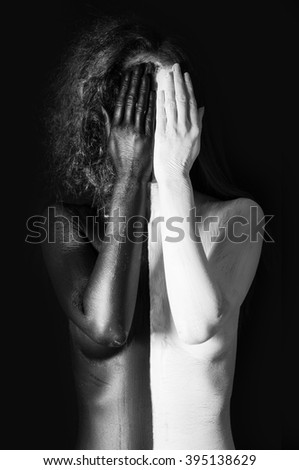 Naked woman painted in black and white