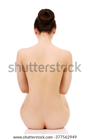 Naked woman sitting. - stock photo